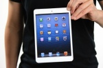 iPad-mini-holding-with-two-fingers